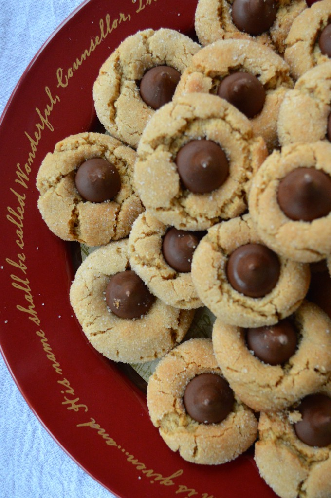 Peanut Butter Blossoms: Christmas Tradition in our house! Christmas cookies make a great dessert to gift to neighbors plus it's an easy cookie recipe!
