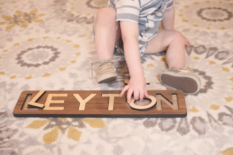Games to play with a toddler: Wooden Name Puzzle from Smiling Tree Toys are so wonderful for your babies development. Games for your toddler from Heather Brown of MyLifeWellLoved.com