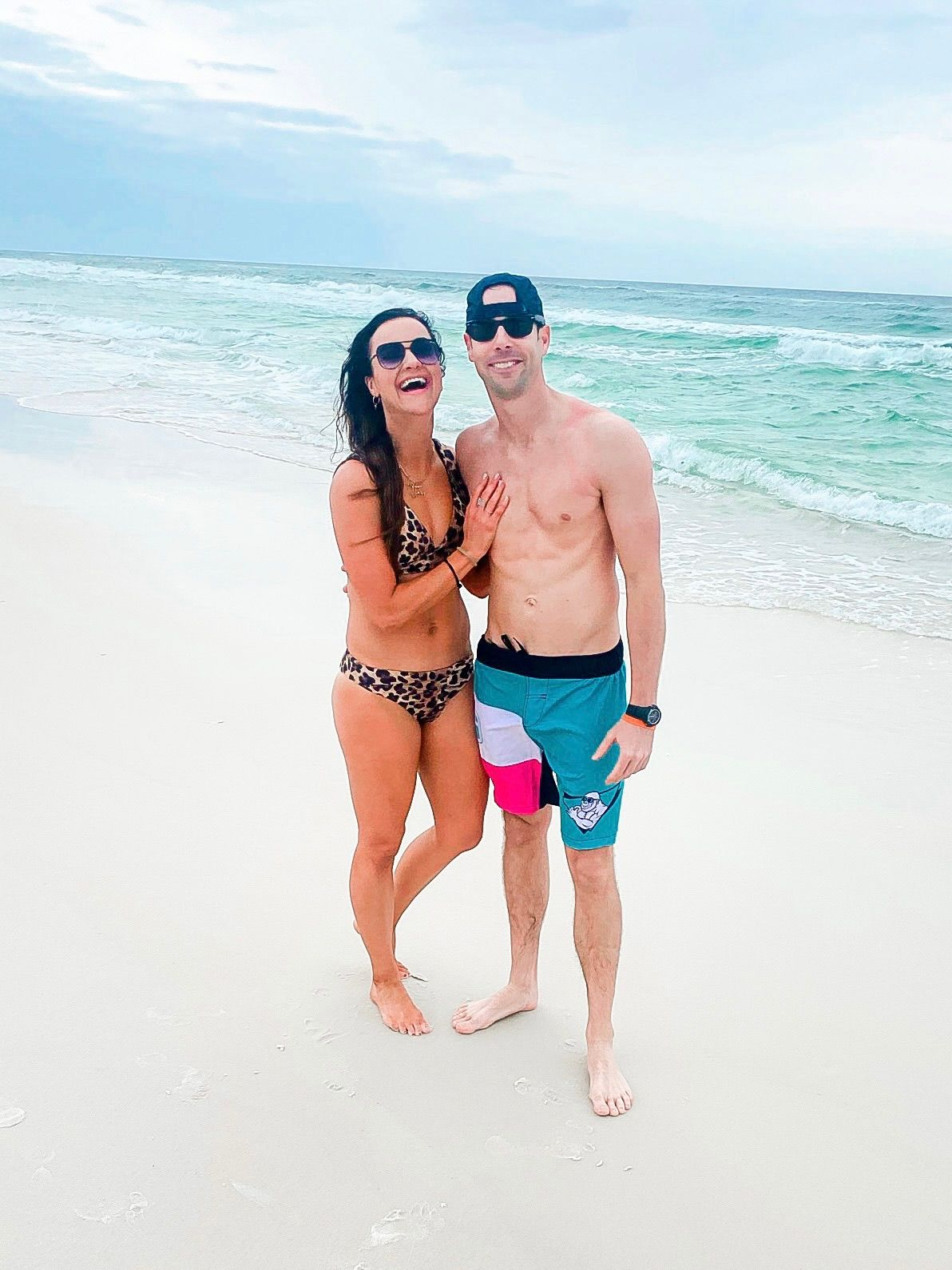 Husband and wife photo at the beach, couples swimwear
