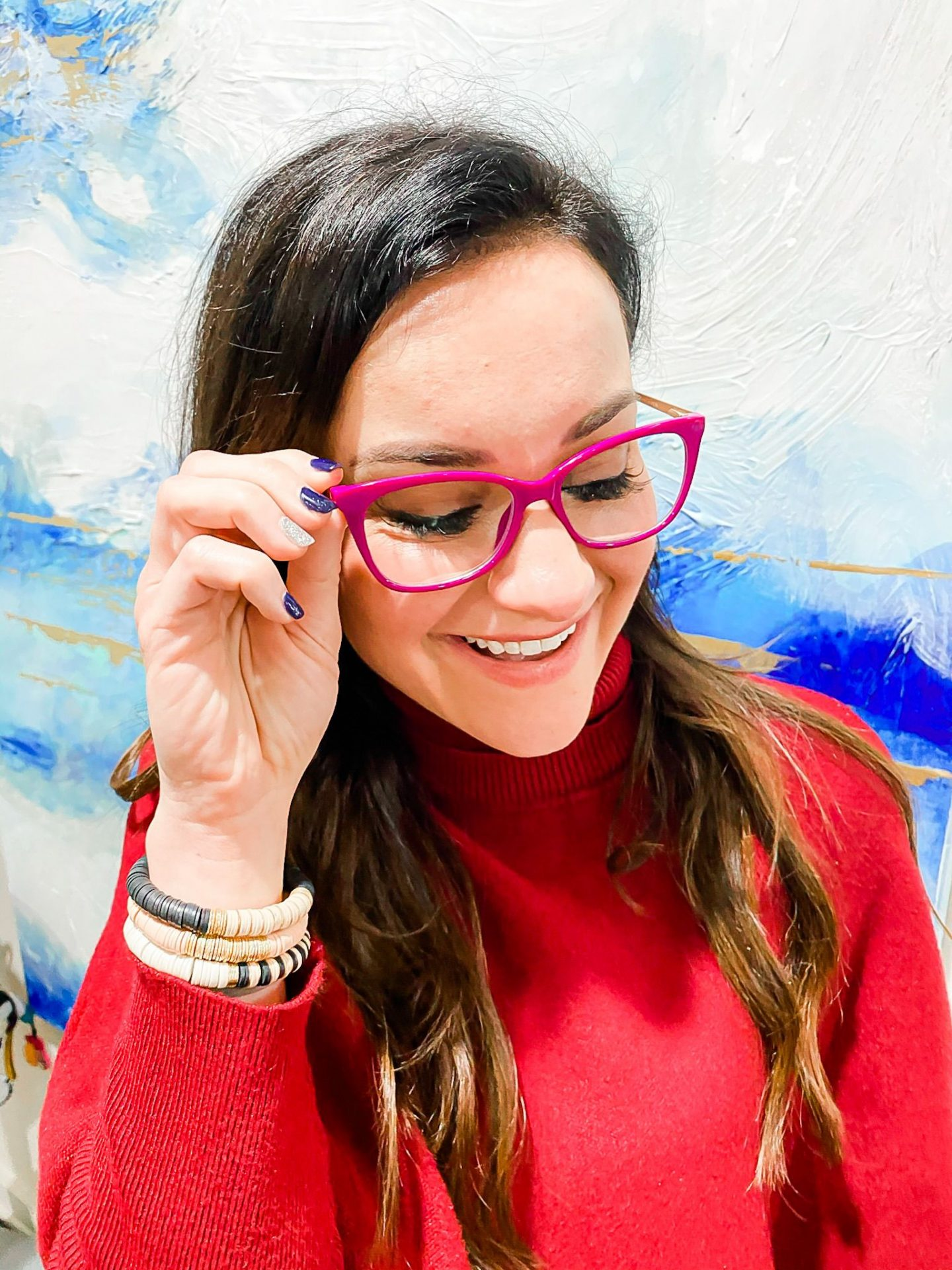 Brunette girl wearing pink glasses, blue light blocking glasses